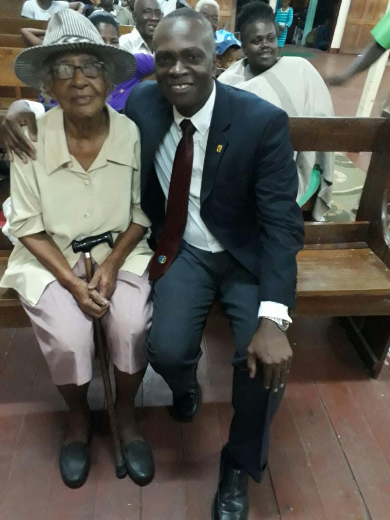 Pastor Hall and elderly lady